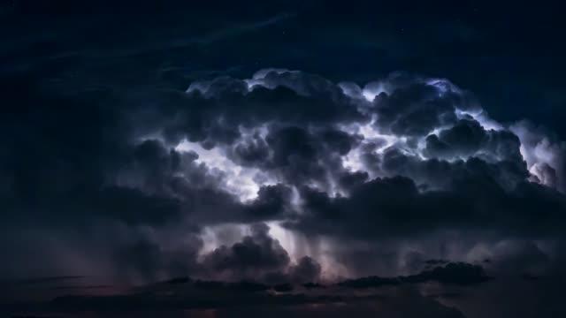 heavy thunderstorm with lightnings - 放電点の映像素材/bロール