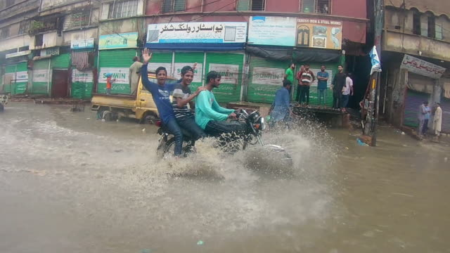 heavy torrential rains flood karachi as the annual monsoon downpour hits the region, swamping streets in pakistan's largest city on 25, august 2020 - monsoon stock videos & royalty-free footage