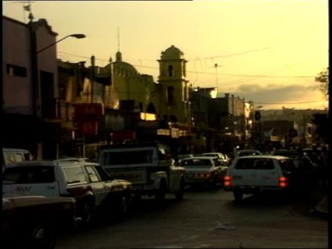 heavy traffic and buildings on tijuana street - tijuana stock videos & royalty-free footage