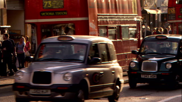 heavy traffic and double decker buses move through london. - double decker bus stock videos & royalty-free footage