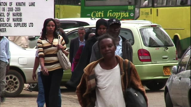 heavy traffic and pedestrians crowd the streets of nairobi. - nairobi stock videos and b-roll footage