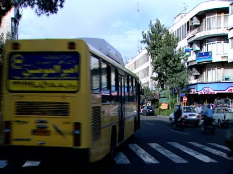 vídeos de stock e filmes b-roll de ms heavy traffic at an intersection / tehran, iran - formato letterbox