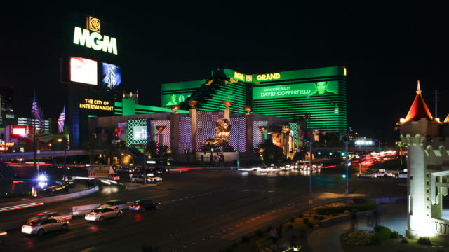 heavy traffic at night on las vegas boulevard passes the mgm grand. - mgm grand las vegas stock videos & royalty-free footage