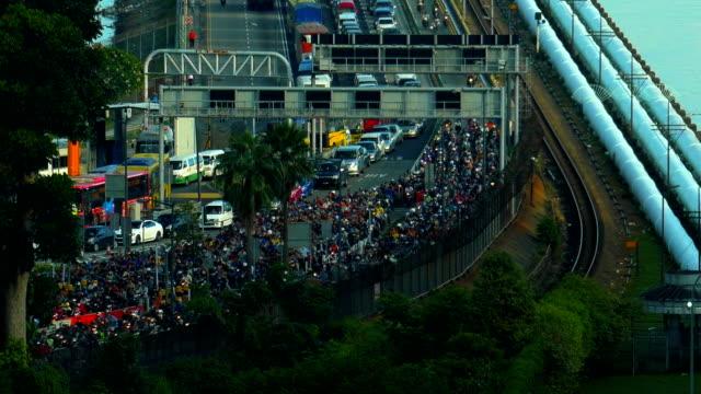 a heavy traffic at the singapore causeway bridge - causeway stock videos & royalty-free footage