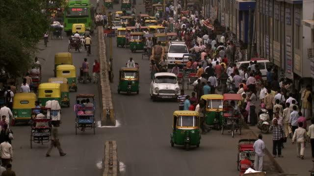 heavy traffic crowds an agra street. - agra video stock e b–roll