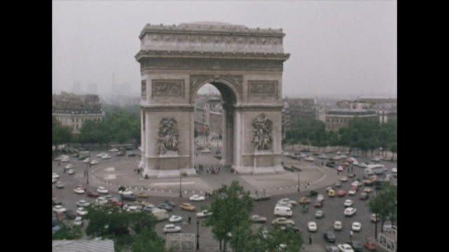 heavy traffic driving around the arc de triomphe in paris; 1972 - french revolution stock videos & royalty-free footage