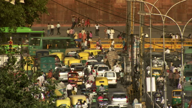 Heavy traffic fills a street below Delhi's Red Fort.