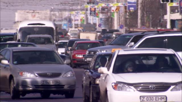 heavy traffic flows along a street in astana kazakhstan. available in hd. - kazakhstan stock videos and b-roll footage