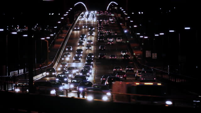 Heavy traffic flows over the Golden Gate Bridge at night.