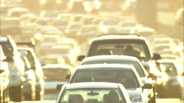 heavy traffic flows slowly along a street in los angeles. - heat haze stock videos & royalty-free footage