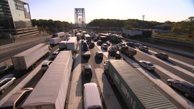 Heavy traffic flows toward a bridge in New York City.