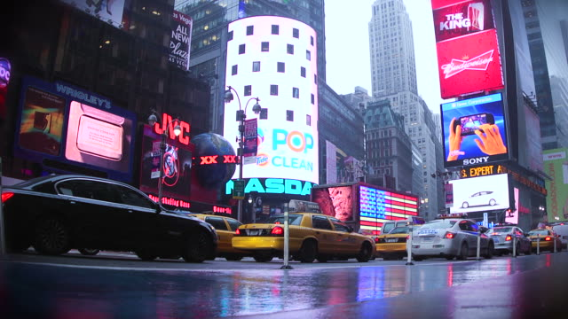 heavy traffic in timesquare, rainy day - electronic billboard stock videos and b-roll footage