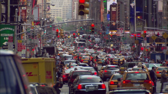 Heavy traffic making its way down a street in New York City.