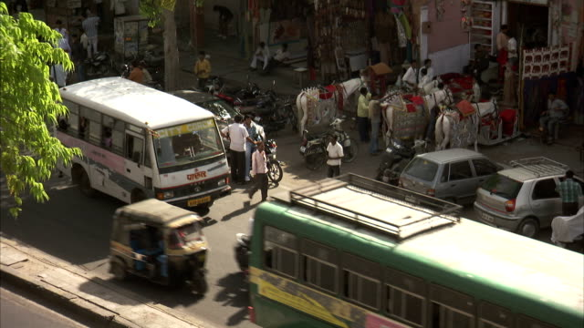 Heavy traffic moves along a street in Jaipur. Available in HD
