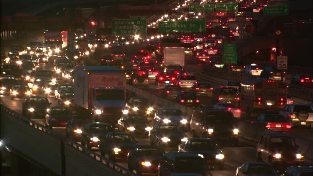 Heavy traffic moves along Boston's Big Dig at night.
