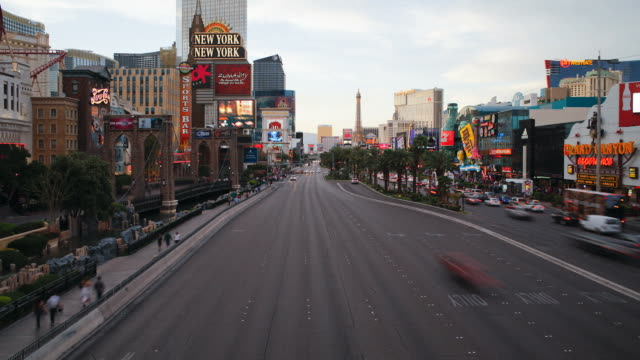 heavy traffic moves along las vegas boulevard. - the strip las vegas stock videos & royalty-free footage