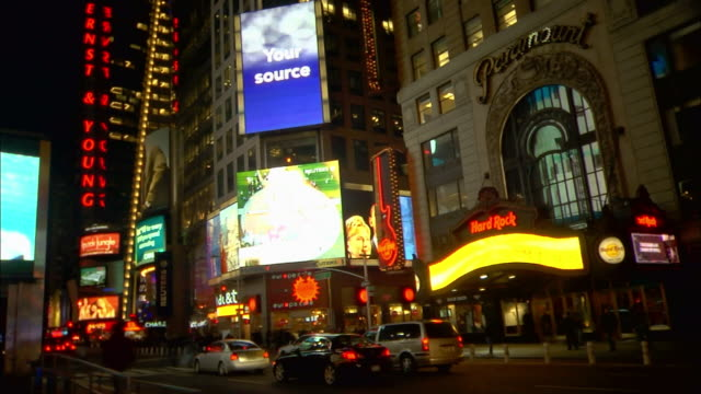 heavy traffic moves down a street in times square. - times square manhattan stock videos & royalty-free footage
