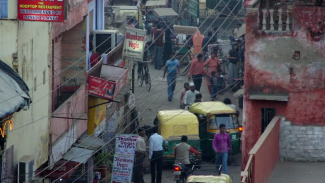 heavy traffic moves through a narrow street in agra. - agra stock videos and b-roll footage
