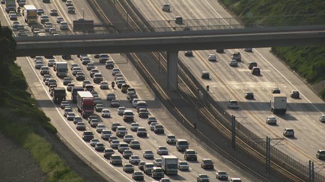Heavy traffic moving eastward on Interstate 105 in Los Angeles, California.