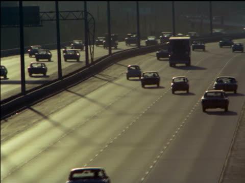 1971 heavy traffic on 401 expressway, toronto - 1971 stock-videos und b-roll-filmmaterial