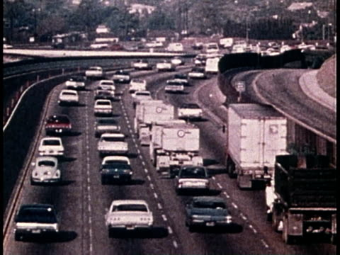 stockvideo's en b-roll-footage met 1977 montage heavy traffic on a freeway / united states - 1977