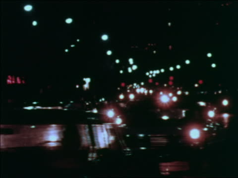 1969 heavy traffic on city street at night / greenwich village, nyc / industrial - greenwich village stock videos & royalty-free footage