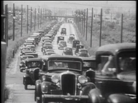 vídeos de stock, filmes e b-roll de b/w 1939 heavy traffic on highway / documentary - 1930 1939
