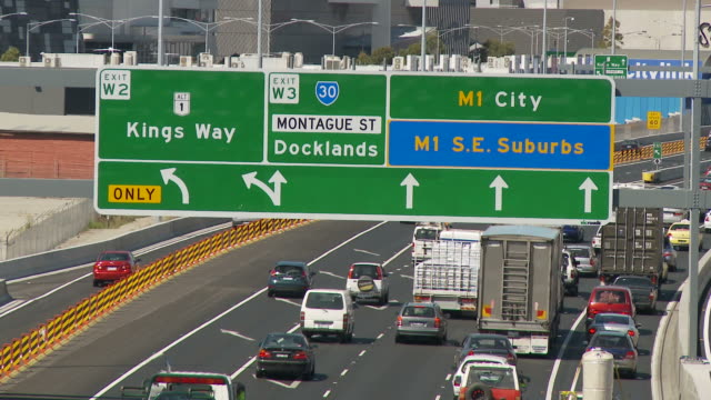 WS HA  Heavy traffic on highway with directional sign hanging above / Melbourne, Australia