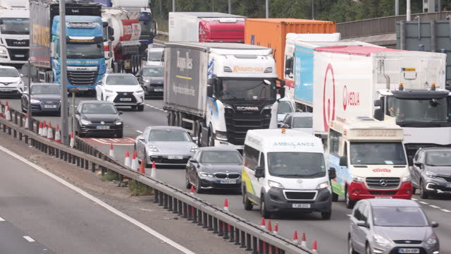 heavy traffic on m25 motorway full of trucks and hgv's , in dartford, kent, u.k., on friday, september 3, 2021. - on the move stock videos & royalty-free footage