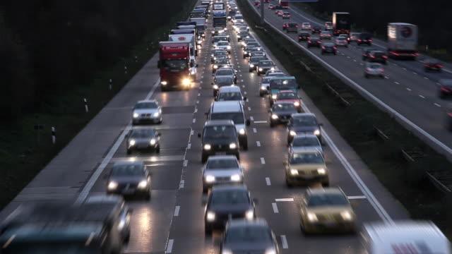 t/l ws ha heavy traffic on motorway at dusk / cologne, north-rhine westphalia - north rhine westphalia stock videos & royalty-free footage