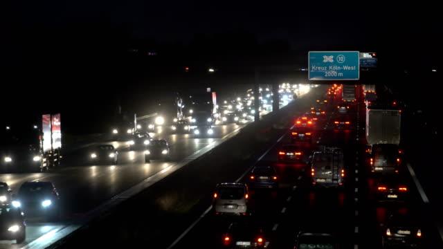 heavy traffic on motorway at night - stau stock-videos und b-roll-filmmaterial