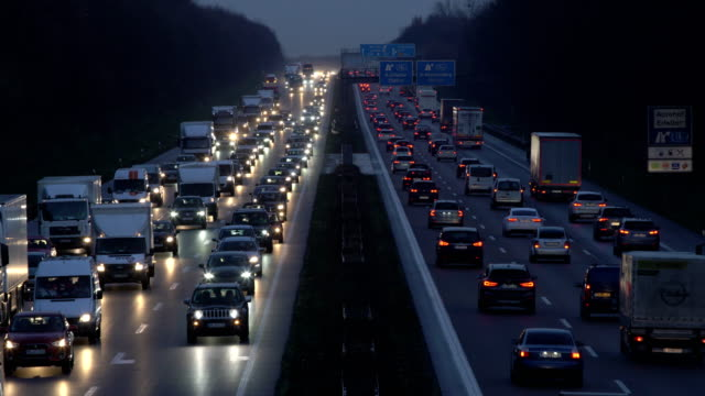 heavy traffic on motorway (dusk) - stau stock-videos und b-roll-filmmaterial