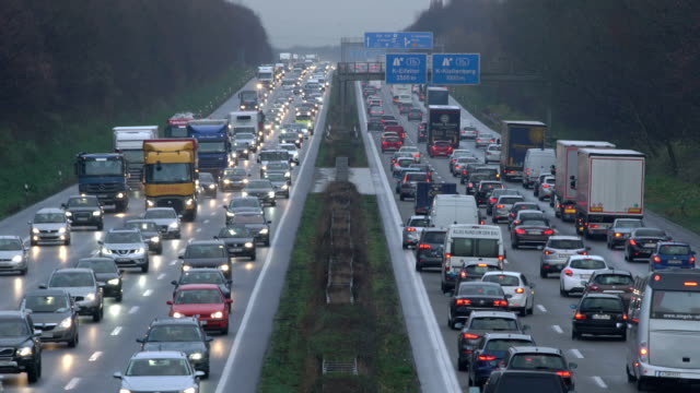 zi heavy traffic on motorway (dusk) - traffic jam stock videos & royalty-free footage