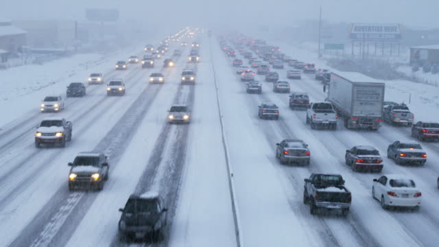 ws ha heavy traffic on snowy road, orem, utah, usa - orem utah stock videos & royalty-free footage