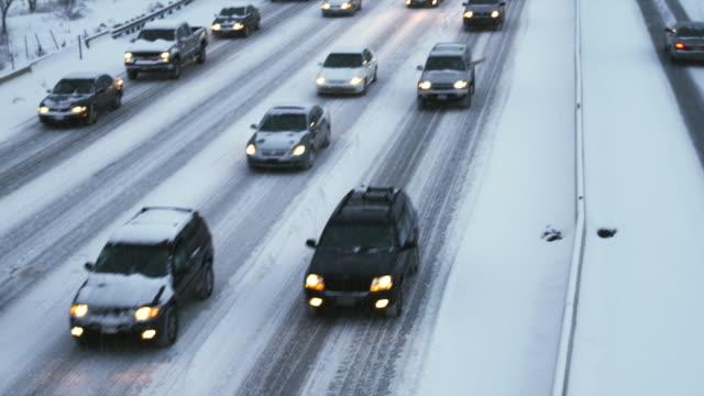 tu ws ha heavy traffic on snowy road, orem, utah, usa - orem stock-videos und b-roll-filmmaterial