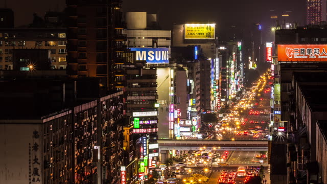 heavy traffic passing in tapei city at night, taiwan - taipei stock videos & royalty-free footage
