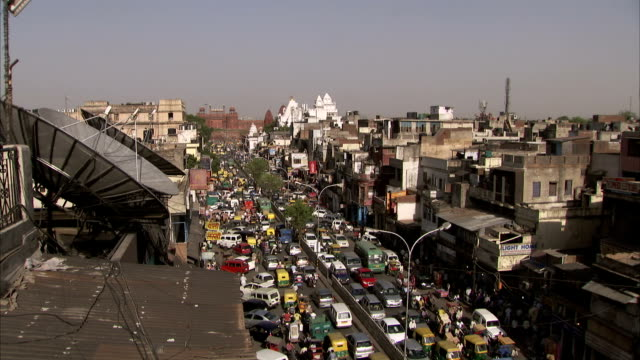 Heavy traffic streams through Delhi, India.