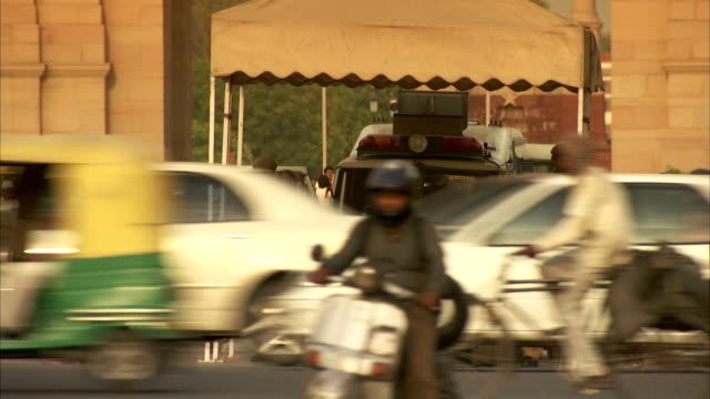 heavy traffic streams through delhi, india. - delhi stock videos & royalty-free footage