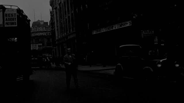 heavy traffic streams through london and past trafalgar square. - double decker bus stock videos & royalty-free footage