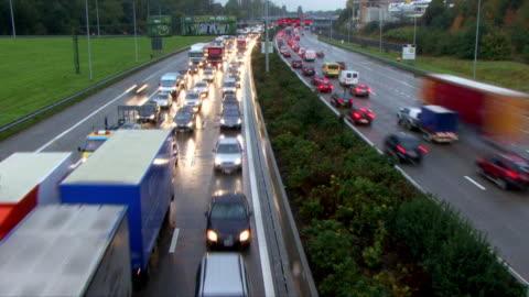 heavy traffic timelaps-loop - traffic jam stock videos & royalty-free footage