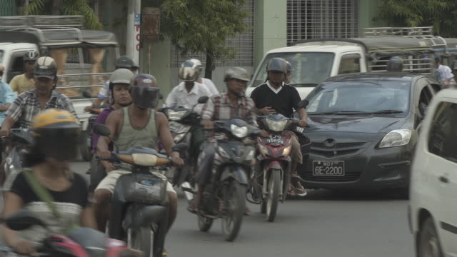 W/S heavy traffic w/ scooters, center of Mandalay city, Myanmar