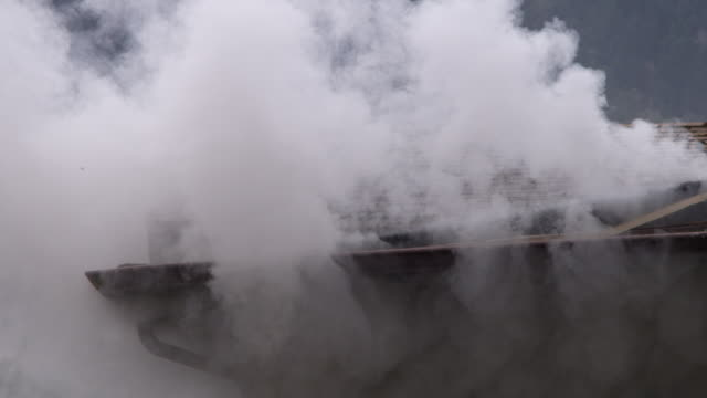 heavy white smoke escaping from around the gutter of a burning house - myrtle creek stock videos & royalty-free footage