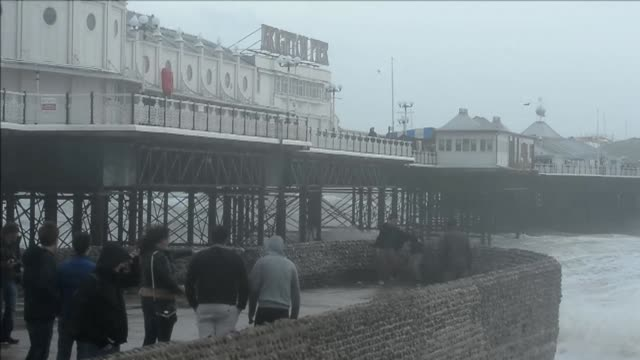 heavy wind and large waves batter the brighton seafront on the south coast of england as a predicted storm touted as britains worst storm in a decade... - east sussex stock videos & royalty-free footage
