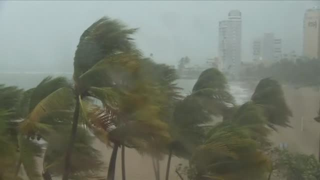 Heavy winds and rain batter the beaches of Puerto Rico as the US territory braces for Category Five Hurricane Irma