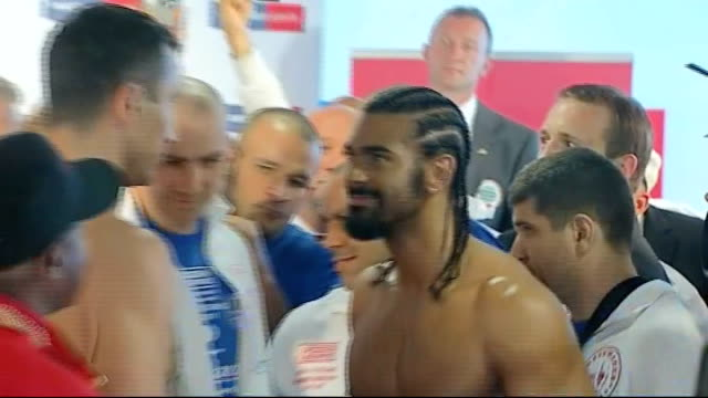 build up to haye v klitschko title fight boxing announcer michael buffer introducing haye at the weighin for the fight haye to stage haye and... - heavyweight stock videos and b-roll footage