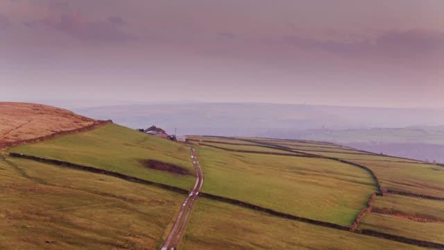 hebden bridge road in yorkshire farmland - drone shot - pennines stock videos and b-roll footage