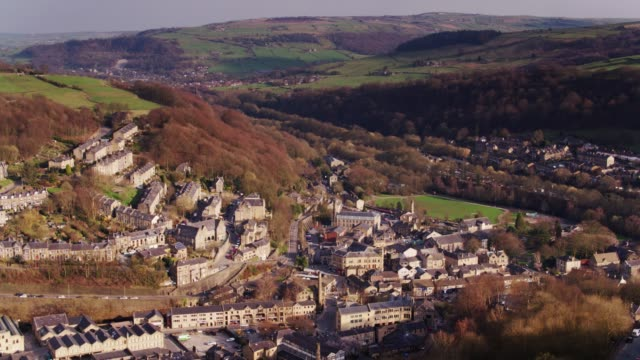 hebden bridge with mytholmroyd in distance - drone shot - west yorkshire stock videos & royalty-free footage