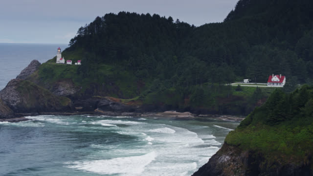 heceta head lighthouse and beach on oregon coast - drone shot - extreme terrain stock videos & royalty-free footage