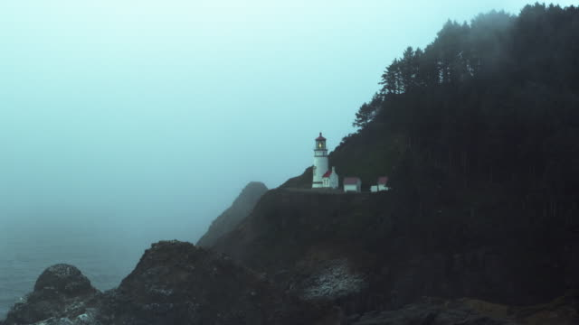 heceta lighthouse in the fog long shot cool - heceta head stock videos & royalty-free footage