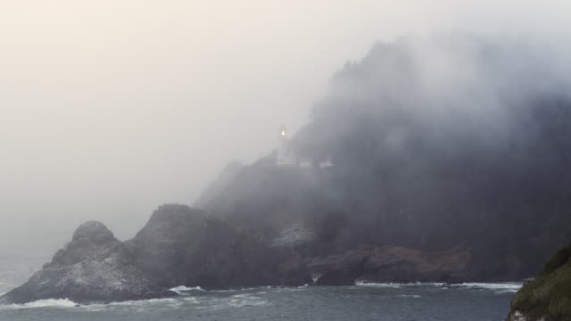 heceta lighthouse in the fog long shot - heceta head stock videos & royalty-free footage